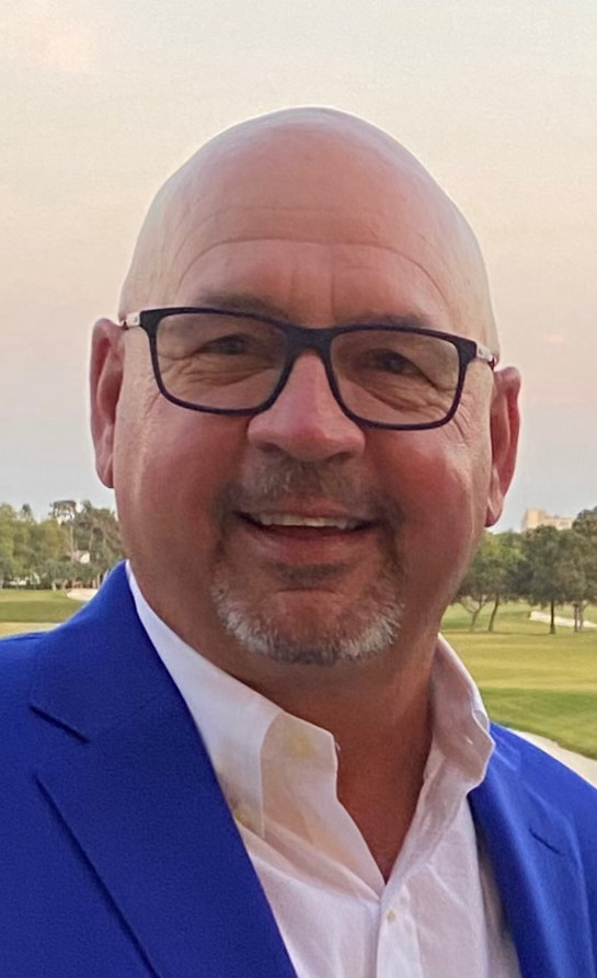 Headshot of Jim Skillman, TableX owner, in blue suit standing outside